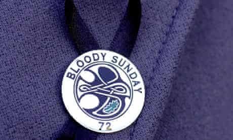 Victim's family member wearing Bloody Sunday badge