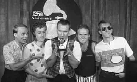 Men at Work pose with their Grammy in 1983