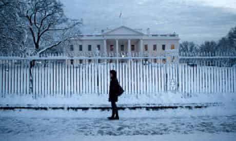 A woman walks on Pennsylvania Avenue in front of the White House after a snow storm