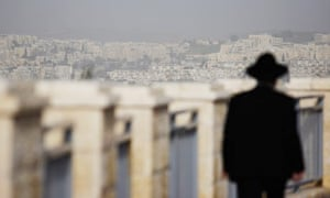 An ultra-Orthodox Jewish man walks in East Jerusalem, where Israel plans to build 1,600 homes.