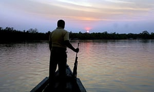 An forest official returns to his base as the sun sets at Sunderbans