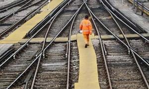 Rail worker train tracks at Clapham Junction