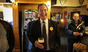 Ukip leader Nigel Farage shares a joke in the pub with party workers after campaigning in Winslow.