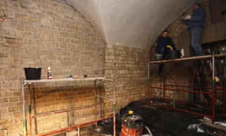 Workers make final preparations in the cathedral crypt at Wawel Royal Castle in Krakow