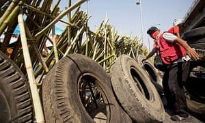 Red Shirt protesters build a barricade using bamboo poles and tyres at an intersection in Bangkok.