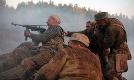 Nikita Mikhalkov shooting a weapon on the set of his film