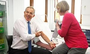 Tony Blair has his blood pressure taken by a nurse at a health centre in Harrow, north London