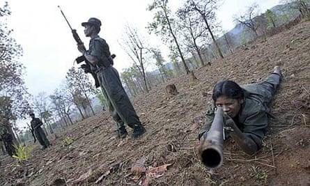 Maoist rebels exercise at a base in the Abujh Marh forests, Chattisgarh, in 2007.