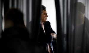 Gordon Brown consults staff in a break between interviews with TV political journalists
