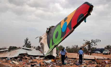 Rescue teams search the site of the Afriqiyah Airways plane crash in Tripoli, Libya
