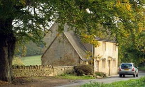 Driving along a country lane in The Cotswolds west central England UK motoring