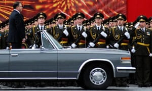 Russian defence minister Anatoly Serdyukov in his open ZiL limousine at a Red Square military parade