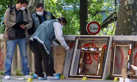 Police officers search for clues outside the Paris Museum of Modern Art