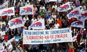Communist labour union members march in Athens during a nationwide strike in Greece