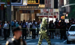 A NYPD Bomb Squad officer walks away from a suspicious package at Times Square in New York