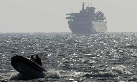 Gaza flotilla lead ship Mavi Marmara escorted by speedboat near Ashdod
