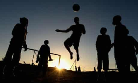 Cape Town, South Africa: Children play football in the Kayelitsha Township
