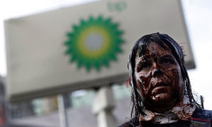 A protester demonstrates at a BP petrol station in Manhattan