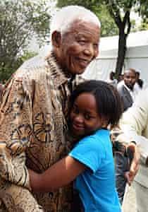 Nelson Mandela hugs his great-granddaughter Zenani, in 2008.