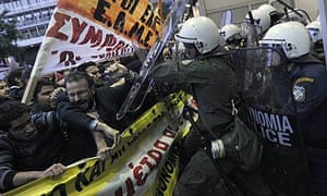 Protesters clash with riot policemen in front of the finance ministry at a demonstration in Athens