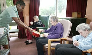 A carer with residents in an old people's home in East Twickenham