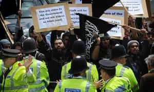 Protesters with police during a soldiers' parade in Barking, East London