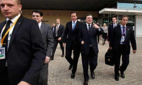 David Cameron walks to an EU summit