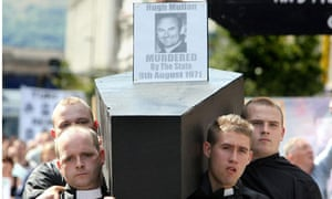 Protesters carry a coffin in west Belfast commemorating the 1971 'Ballymurphy massacre'.