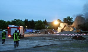 An ambulance rushes to the site of a bomb that exploded while experts were trying to defuse it.
