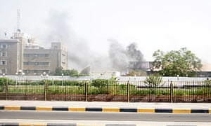 Smoke rises from police compound in the southern Yemeni port city of Aden