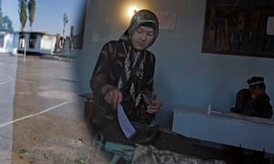 An ethnic Uzbek woman casts her ballot at a polling station in Osh, Kyrgyzstan