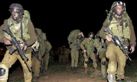 Israeli soldiers marching into the Gaza Strip