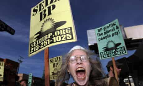 A protester shouts slogans against BP du