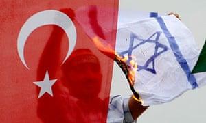 TOPSHOTS A demonstrator burns an Israeli