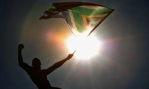 A fan waves a South African flag during the parade in Sandton, South Africa