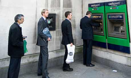 Queue at Lloyds TSB bank cash point machine London England UK