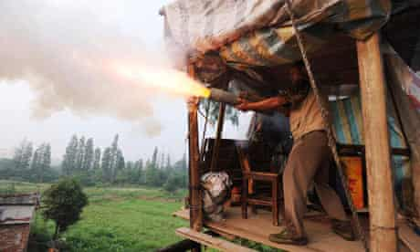 Chinese farmer Yang Youde fires homemade rockets at property developers