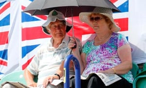 Tennis fans shelter from the hot weather during the Davis Cup at Devonshire Park, Eastbourne.
