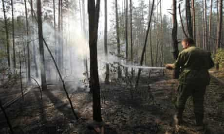 A Russian firefighter works to put out a wildfire