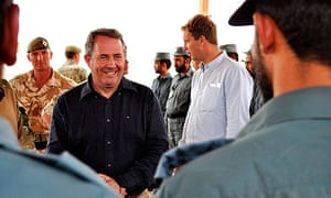 Liam Fox meets Afghan police recruits on a visit to Helmand province
