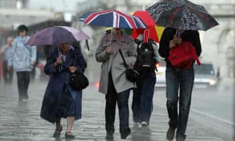People walk through heavy rain in London