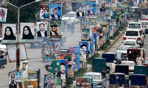 Election posters line a street in Jalalabad
