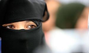 Muslim woman wearing a burqa in Paris, France