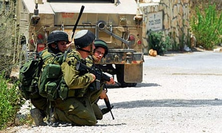 Israeli soldiers take up position near the border with Lebanon after an exhange of fire.