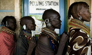 Women from the Turkana tribe line up to vote on a referendum in Loyangalani, north-west Kenay