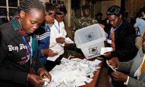 Electoral officials sort out ballots before counting votes at a polling centre in Eldoret town