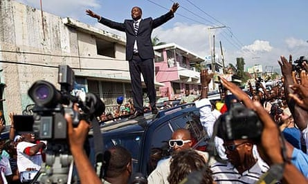 Wyclef Jean greets supporters after submitting paperwork to run for president of Haiti