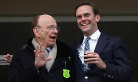 News Corp Chief Executive Rupert Murdoch talks to his son James Murdoch at Cheltenham Festival