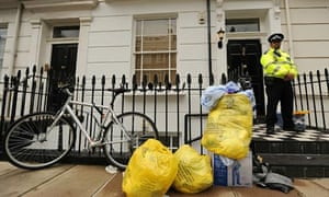 A police officer guards house where Gareth Williams was killed