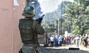 A policeman shoots tear gas grenades at protesters in Maputo, Mozambique.